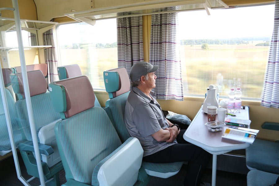 George takes in the scenery on our chartered train ride into Berlin