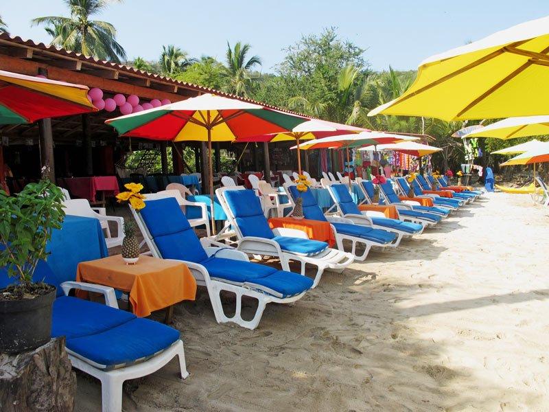 Pick your beach chair! There are lots to choose from at Playa Las Gatas.
