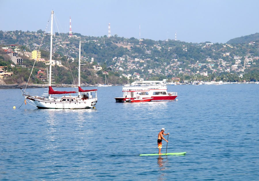 You can get some good core exercise when paddling out on a SUP board from Playa La Ropa.