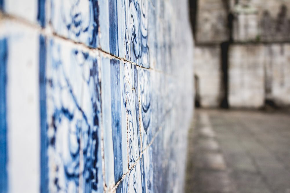 Azulejos were introduced to Portugal in the 15th century by the Spanish.