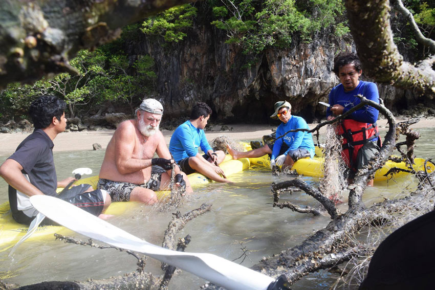 John Gray and guides clean up garbage and abandoned fishing nets in Phang Nga Bay.