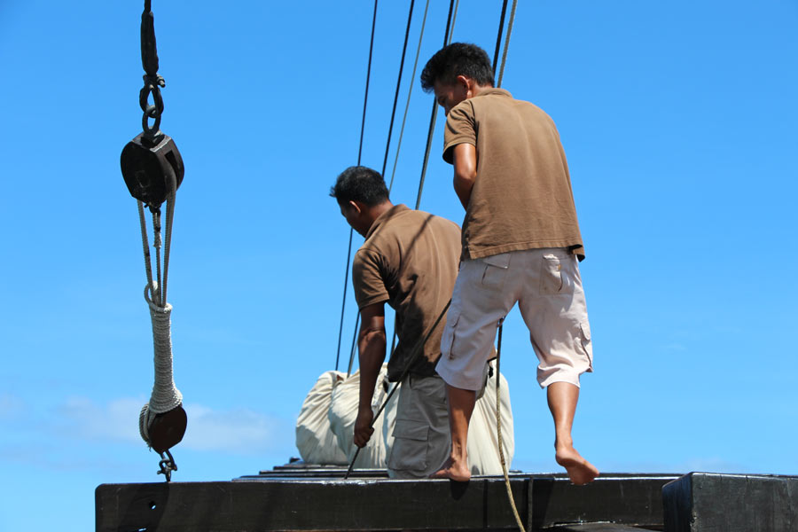 The Alila Purnama is a true sailing ship, and the crew work the sails one afternoon to catch the wind.
