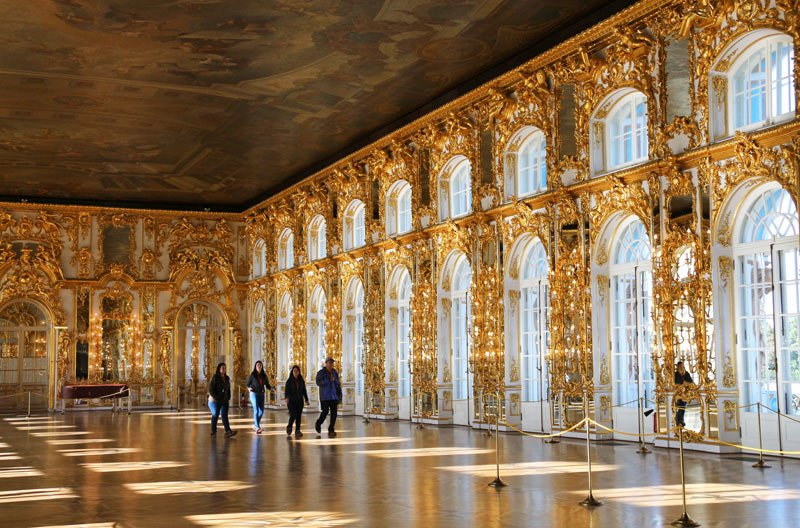 The ornate Great Hall in Catherine Palace was lined with mirrors, gilded carvings and 12 glittering chandeliers.