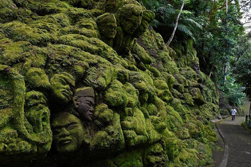 Moss-covered stone carvings at Ayung Resort, Ubud