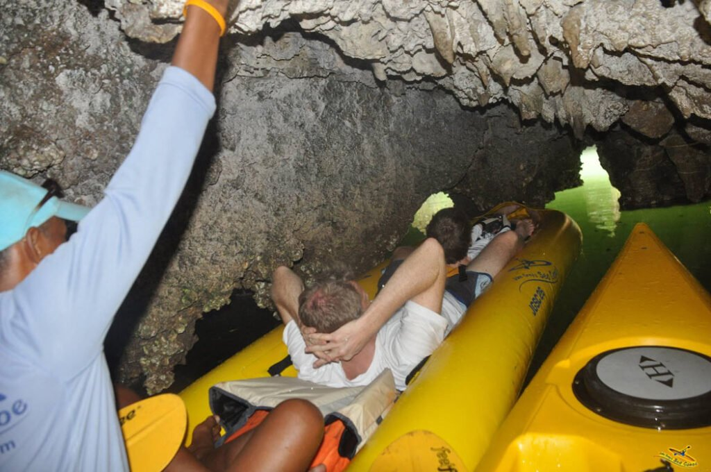 You lie down on your back in the kayak; your guide maneuvers you through tunnels and sea caves.