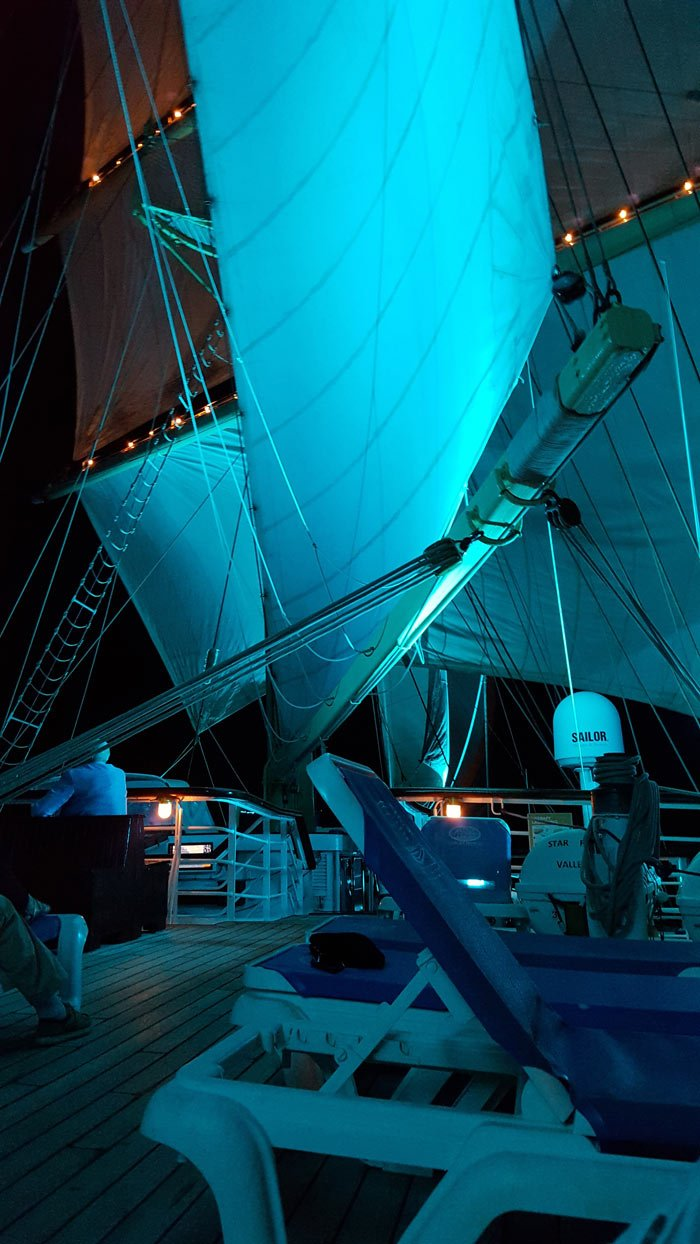 Billowing sails at night on a Star Clippers cruise