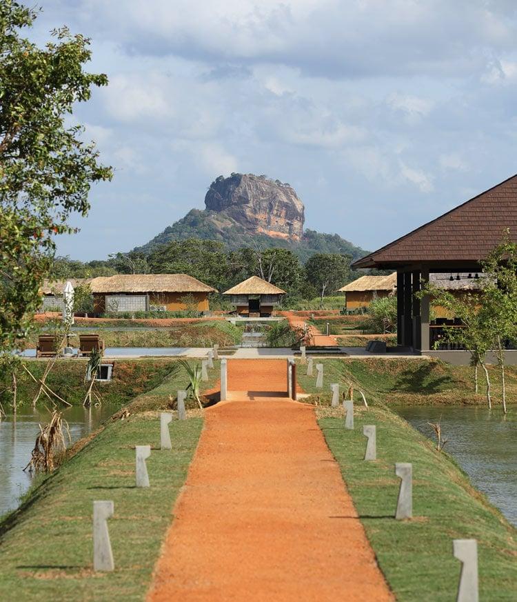 The UNESCO site of Sigiriya Rock dominates the view at Water Garden Sigiriya.