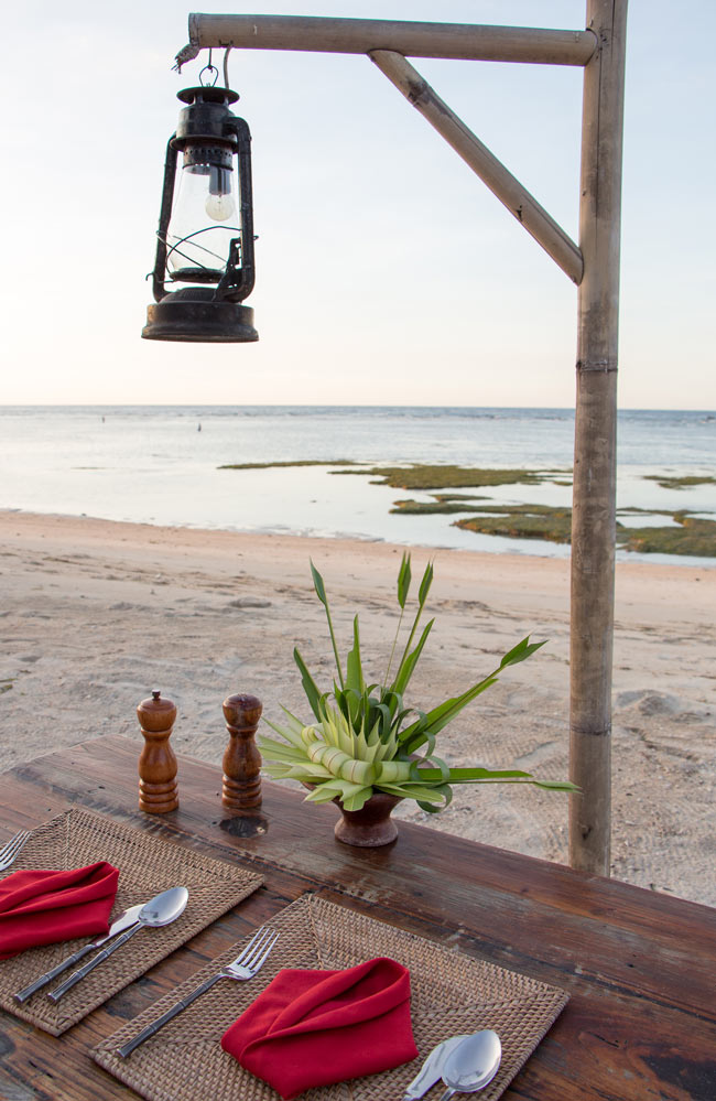 How romantic! Our table is set for dinner on the beach at Hotel Tugu Lombok.