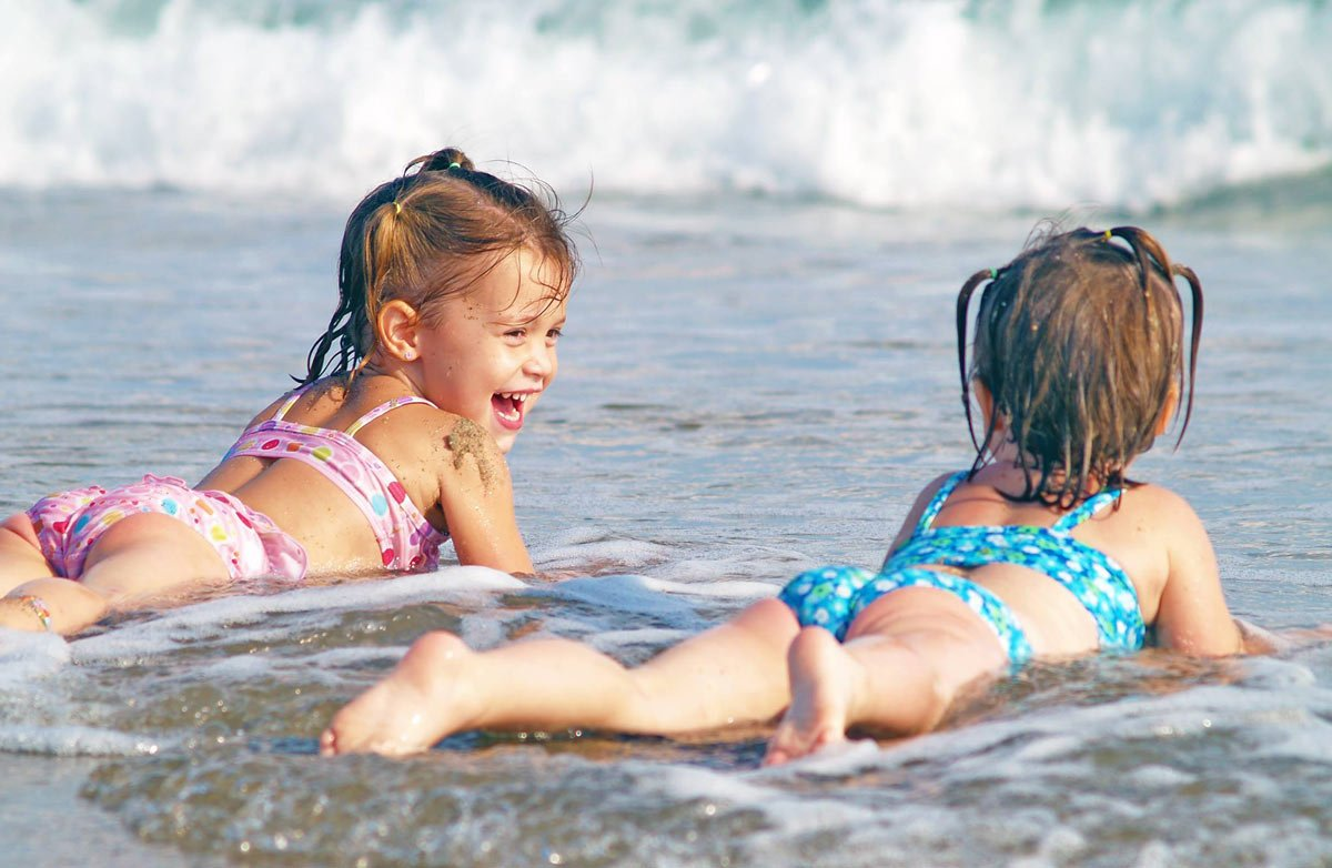 Children love Poipu Beach, as do adults! (Credit: Kiahuna Plantation)