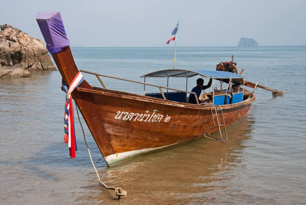 A longtail boat waits for customers in Phang Nga Bay