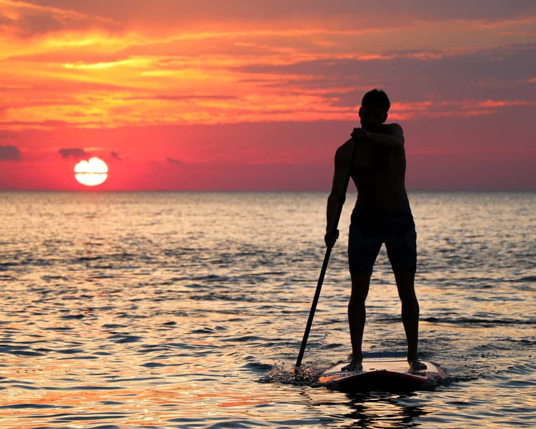Stand-up paddle boarding in Cabo San Lucas is popular early in the morning.