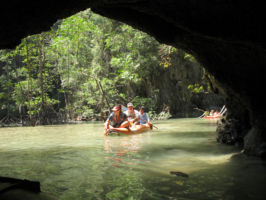 When the tide is right, you can sea canoe through cave tunnels in karst islands in Phang Nga Bay -- one of the best things to do in Thailand!
