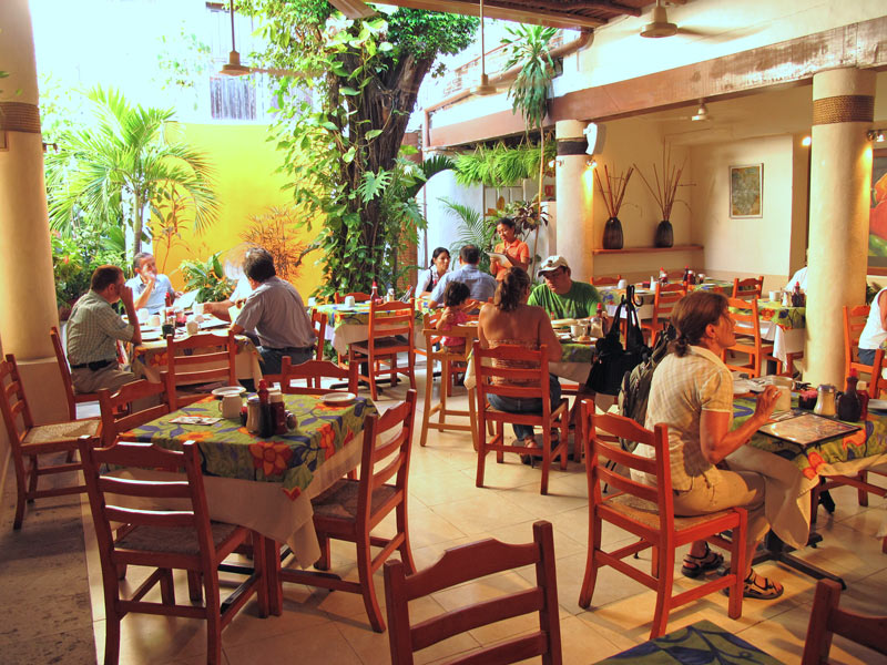 At Fredy's Tucan, you can sit inside in an air-conditioned area or outside in the garden.