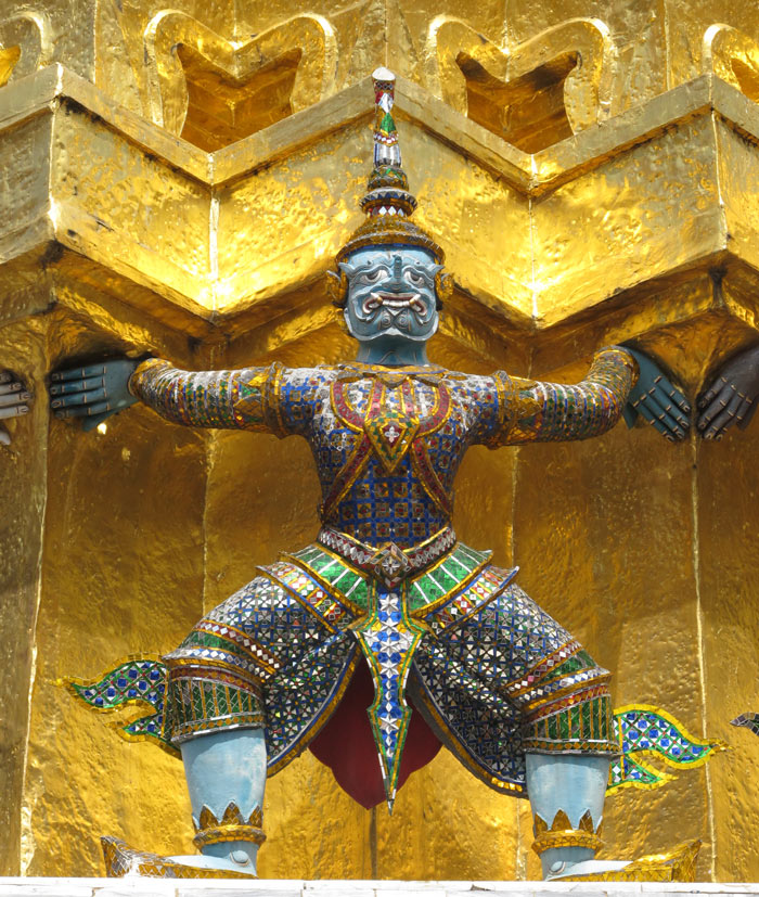 The soaring golden spires, inlaid mother-of-pearl frescoes, jewel-encrusted winged sculptures and gold leaf murals at the Grand Palace, Bangkok, all dazzle the eye.
