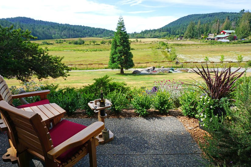 Woodstone Manor on Galiano Island has lovely king-bedded rooms, with patios overlooking bucolic views of rolling green pastures.