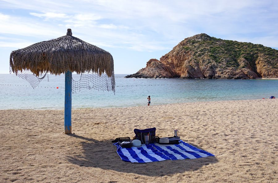 Arrive early to snag one of the four thatch palapas on Santa Maria Beach, Cabo.