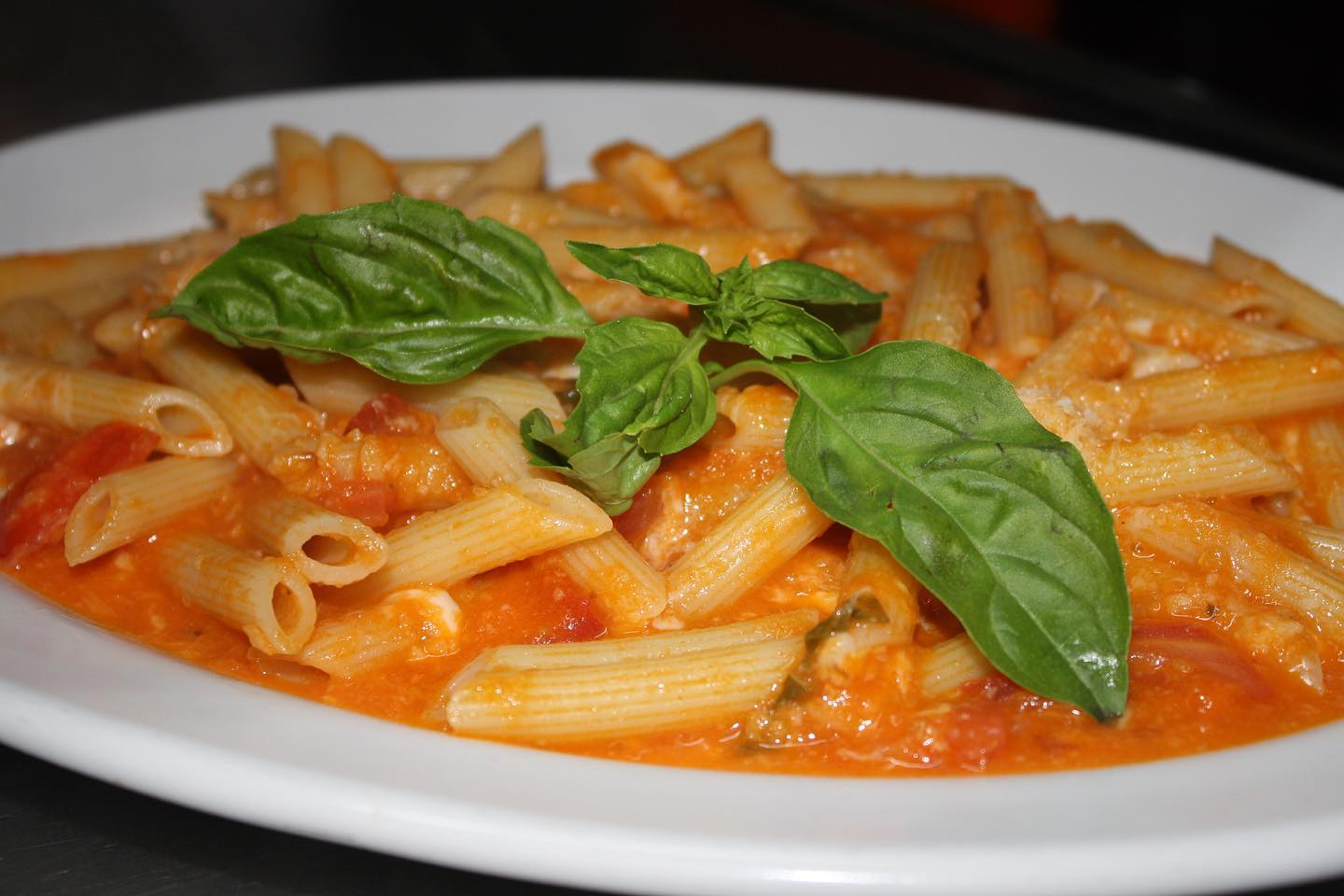 The Penne Dolce at La Dolce in Cabo San Lucas features tomatoes, parmesan, mozza and basil.