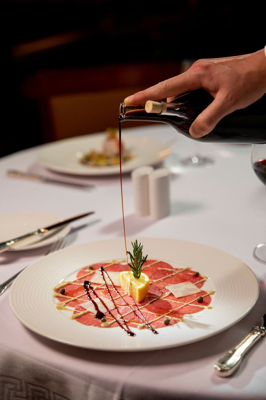 The beef carpaccio is masterfully presented in Crystal Cruises' Prego restaurant.