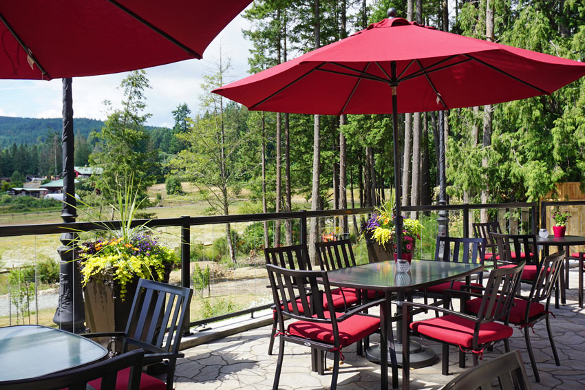Outdoor dining terrace at Woodstone Manor on Galiano Island