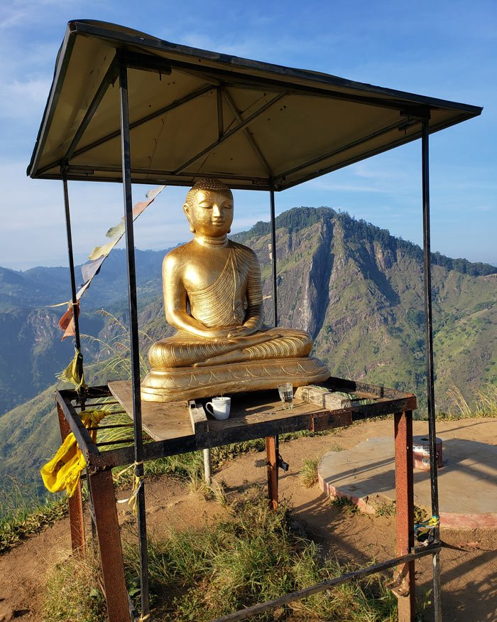 A small Buddha greets you at the top of the Little Adam's Peak hike.