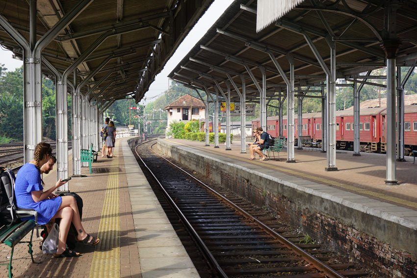 Passengers wait at the Kandy train station