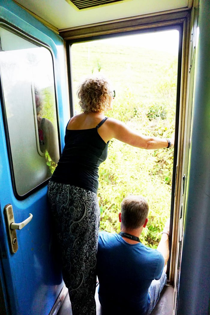 You can hang out the open doorway when riding first class on the Kandy to Ella train.