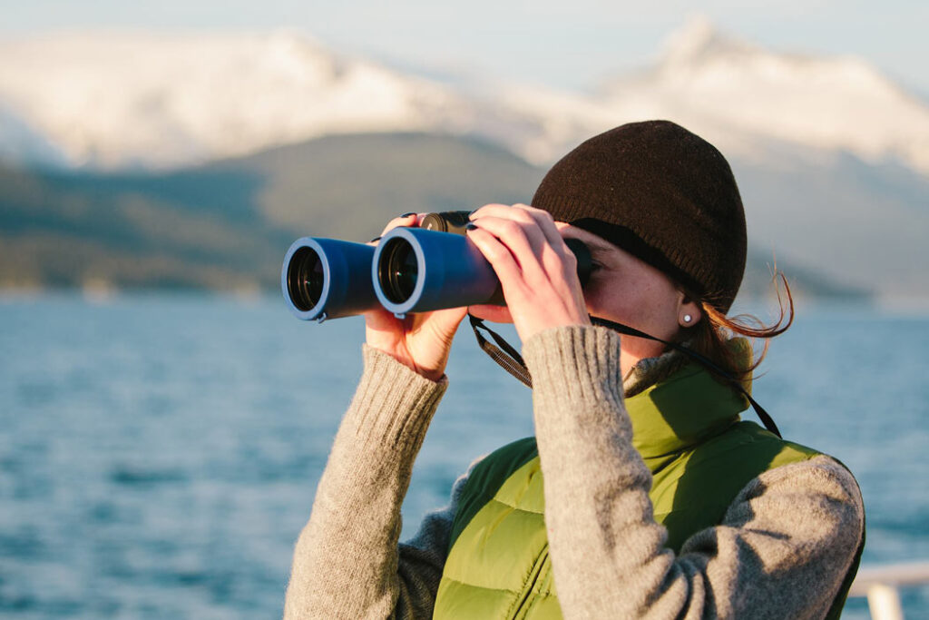 An UnCruise Alaska guest looks for whales