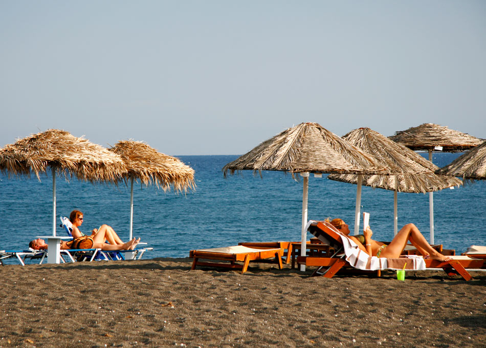 Soaking up the sun on Perissa Beach, Santorini