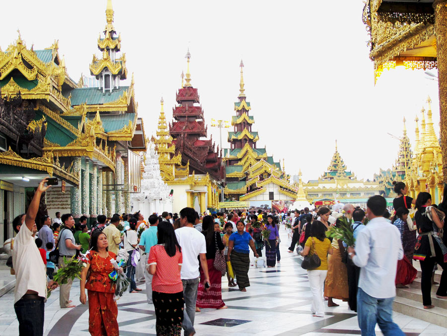 The gold stupa of the Shwedagon Pagoda is surrounded by many smaller shrines.