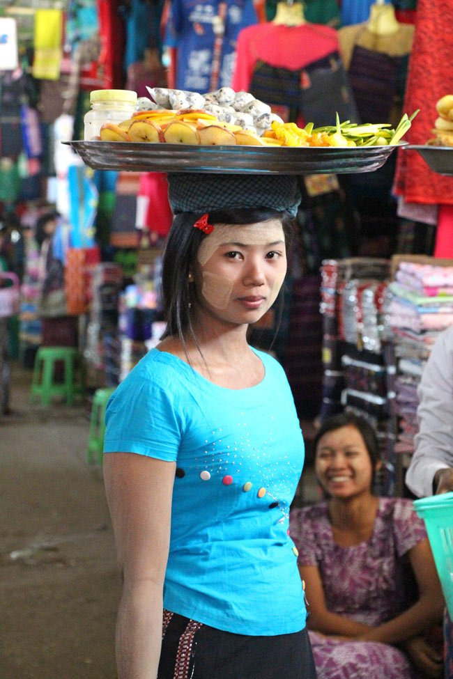 Myanmar lady with thanaka on her face