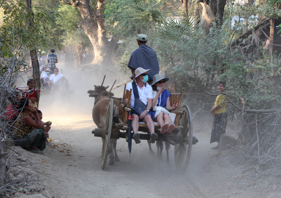 Oxcart ride on our Myanmar river cruise