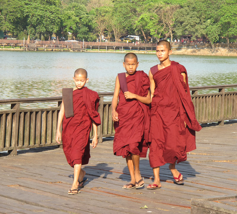 Buddhist monks in Myanmar wear red-colored robes.