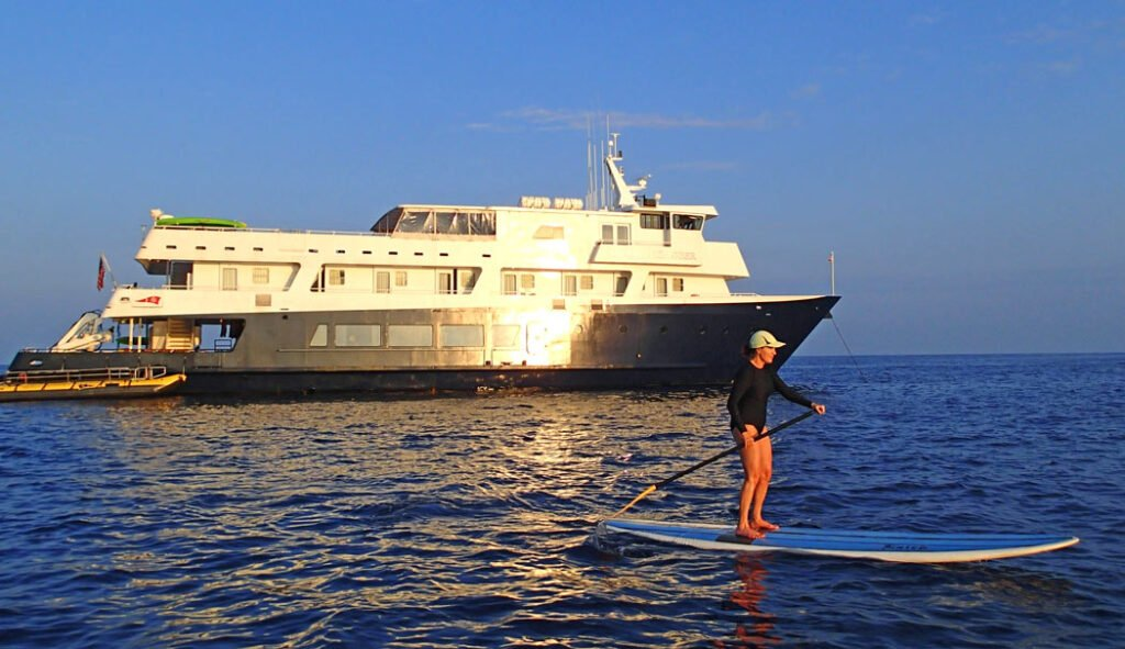 Stand-up paddle boarding by the Safari Explorer on our UnCruise Hawaii trip