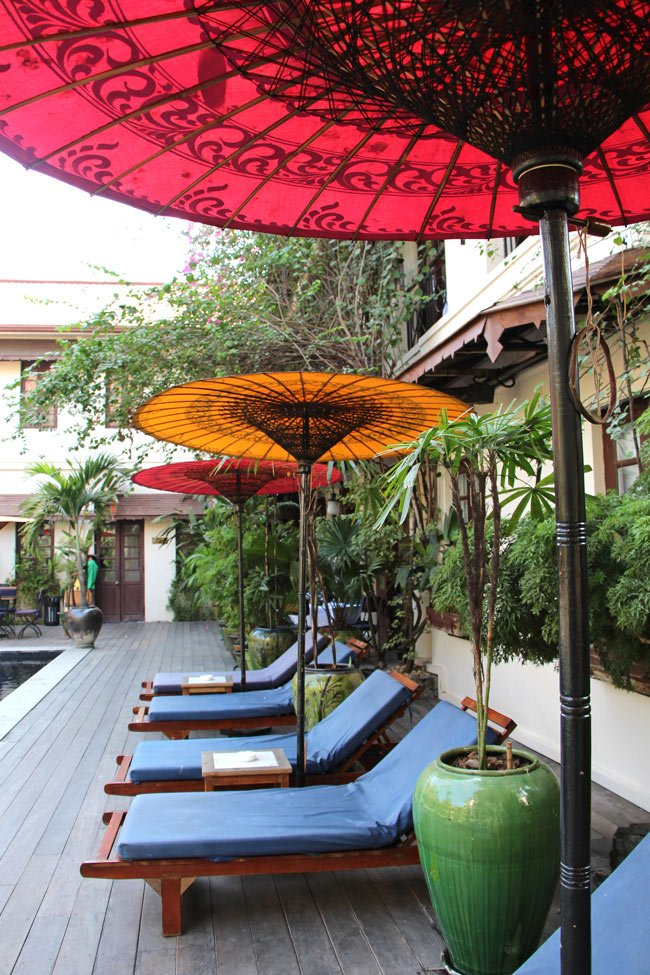 How to handle the heat in Yangon? Lie under one of these parasols by the pool at the Hotel Savoy.
