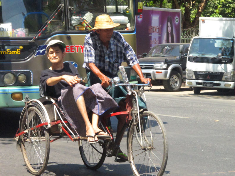 Cars, trishaws and buses all vie for space on Yangong's roads.