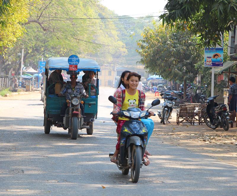 Tuk-tuk and scooter in Magwe, Myanmar