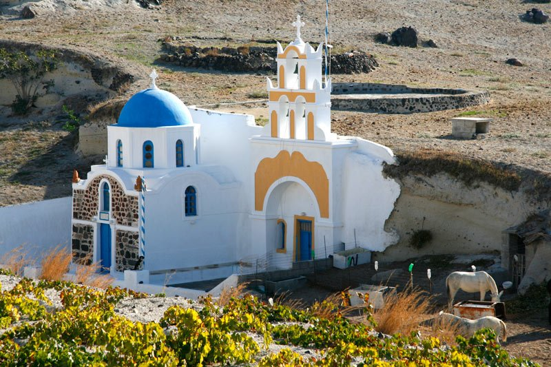 We saw a wedding party gathering outside this church on the outskirts of Megalochori in Santorini.
