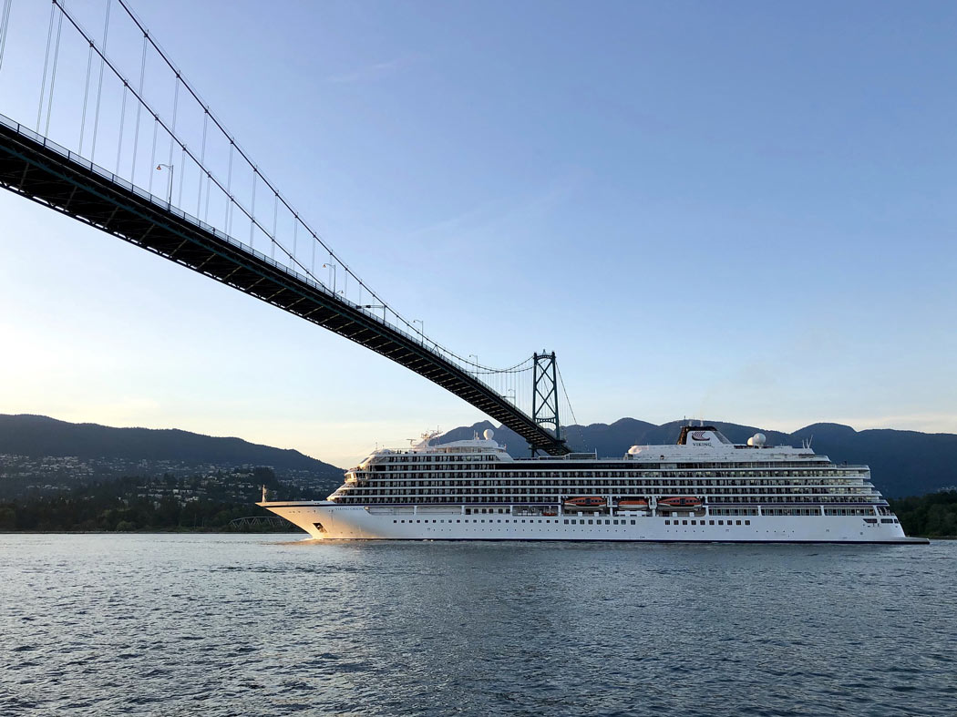 A cruise ship passes underneath the Lions Gate Bridge in Vancouver.