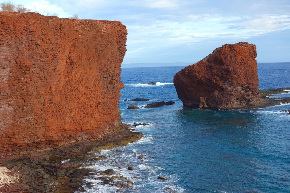 Hike along these red cliffs to Puu Pehe on Lanai