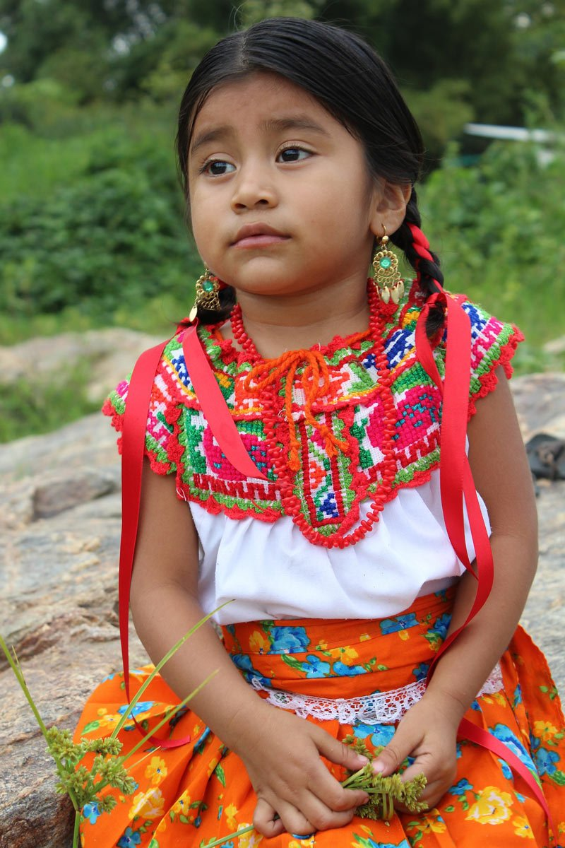 A little Oaxacan indigenous girl in local costume