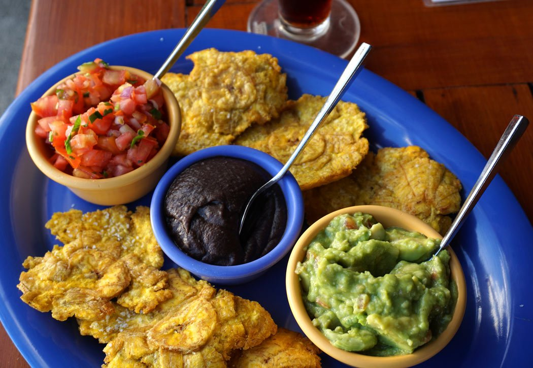 "We tried ""patacones"" (warm fried plantains) for the first time - delicious with salsa, beans and guacamole!"