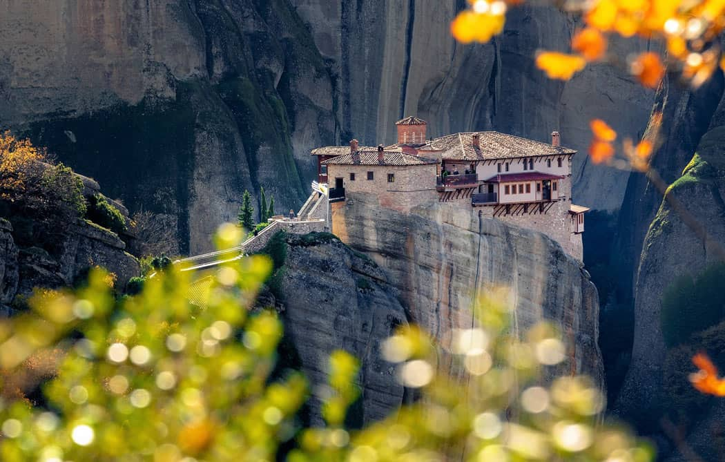 A complex of monasteries perch precipitously on soaring rock formations in Meteora