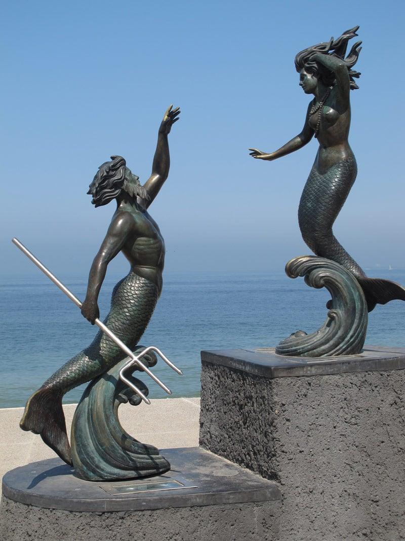 """Sculpture of two mermaid lovers """"Triton and Nereida"""" on Puerto Vallarta's Malecon"""
