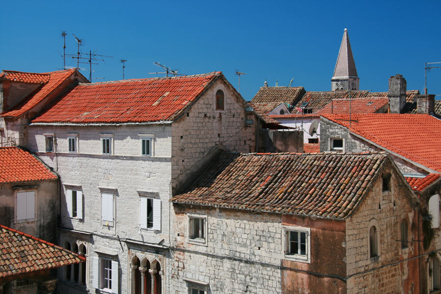 Visit Trogir, and you'll be struck by its red rooftops