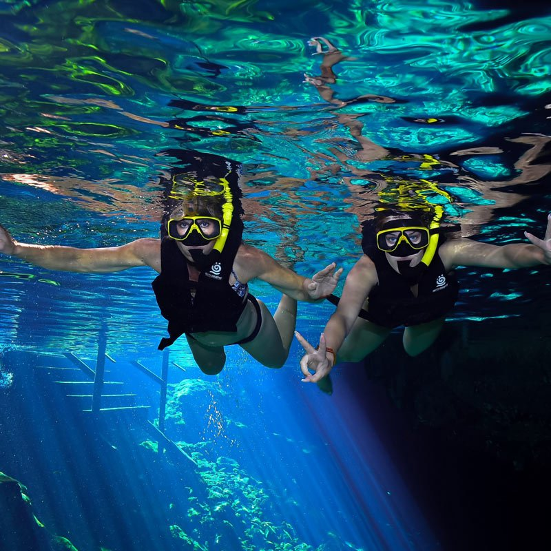 Snorkeling in a cenote in Riviera Maya