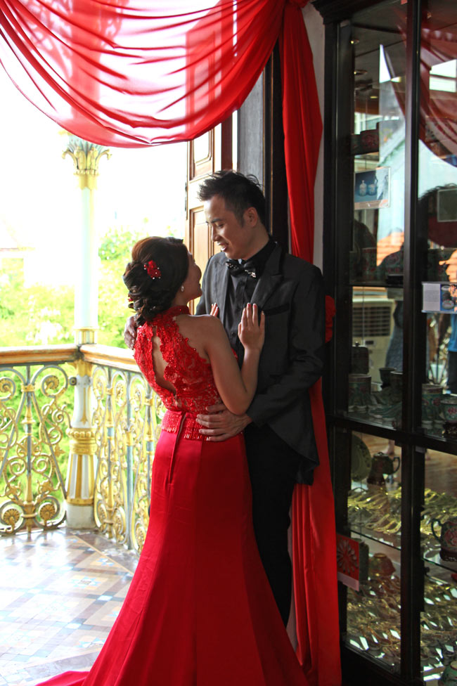 Vivid scarlet (as worn by this bride) is a common color for wedding dresses in Malaysia