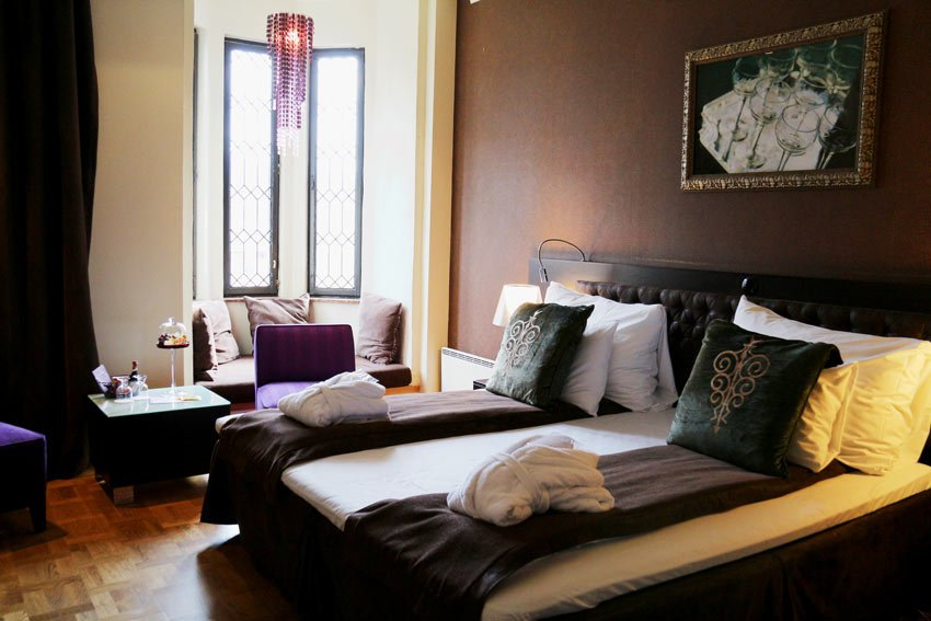 """Our """"Deluxe Double"""" room at Hotel Havnekontoret, with high ceilings, parquet wood floors and a wonderful bay window"""