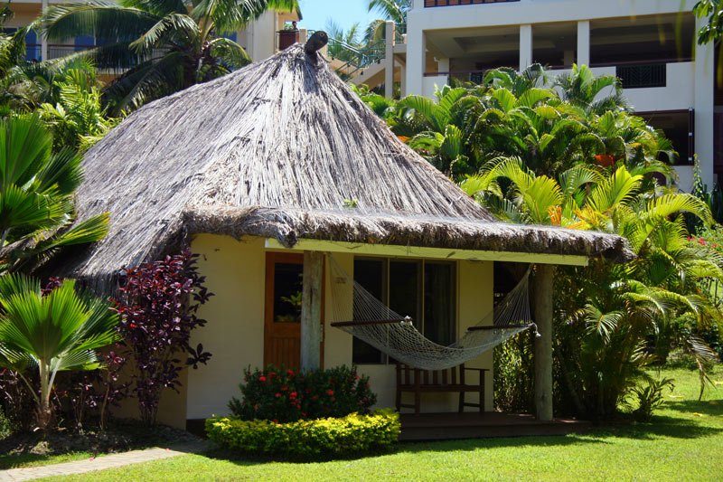 Bures at the Outrigger in Fiji are nestled in the resort's gardens