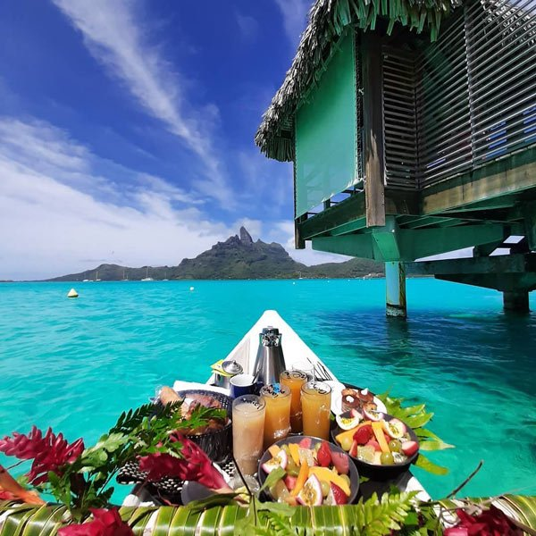 Breakfast delivered by canoe at St Regis Bora Bora