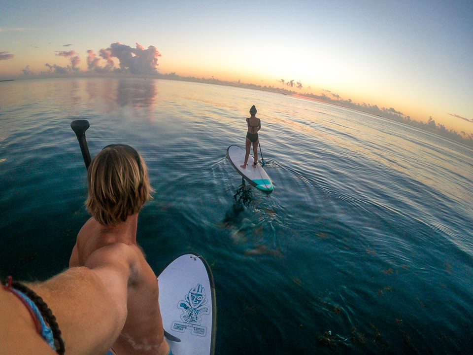Go SUP boarding at sunrise in Playa del Carmen